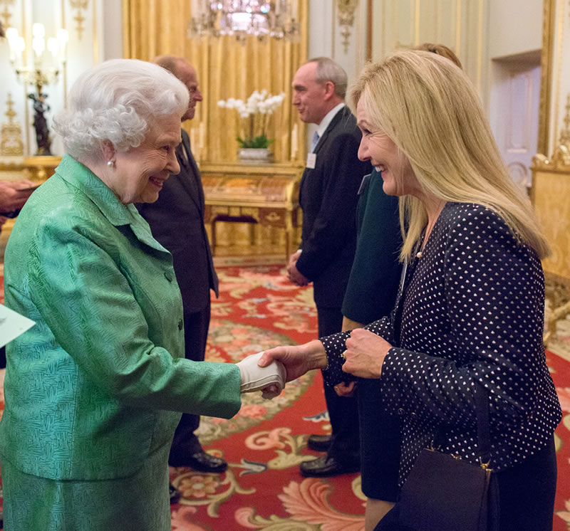 Dr Victoria Edwards attends reception at Buckingham Palace